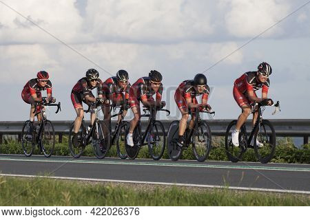 Enkhuizen, The Netherlands - July 2 ,2016: Cyclists Ride In A Row, During A Time Trial Contest For C