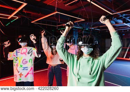 Interracial Gamers In Medical Masks And Vr Headsets Showing Win Gesture.