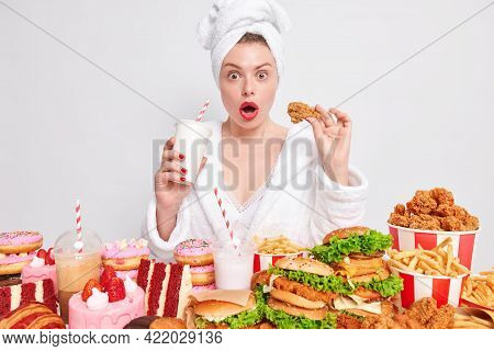 Impressed Young Woman Opens Mouth From Amazement Breaks Diet Eats Junk Food Has Unhealthy Eating Hab