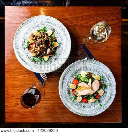 Restaurant Table Set Up For Two Main Dish Fine Dinning White Wine Glass On Wooden Table