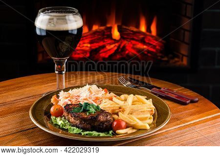 Grilled Beef Steak With French Fries, Tomatoes. Concept For A Tasty And Hearty Meal. Rustic Wooden B