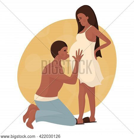 Young Black Couple In Love Waiting For The Birth Of A Baby. The Man Is On His Knees And Kisses His P
