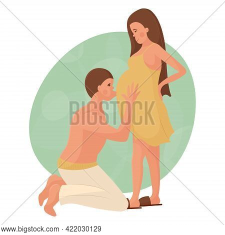Young White Couple In Love Waiting For The Birth Of A Baby. The Man Is On His Knees And Kisses His P