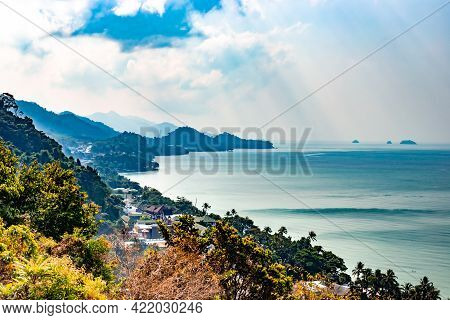 Contrasting Landscape Of The Tropical Seashore With Mountains. Holidays In Asia On An Island In Thai