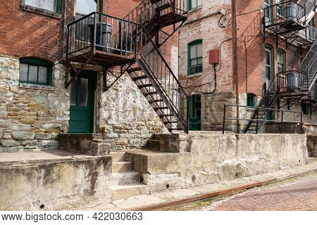 Backdrop Of Fire Escapes, Stairs, Walls, Railings, Windows, Doors, And Walls On The Rear Of An Old B