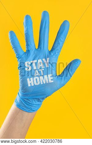 Stay Home Written On The Doctor's Hand With Surgical Glove. Prevent The Spread Of Infectious Disease