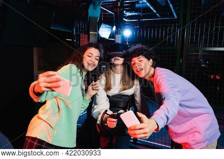 Happy Interracial Friends Taking Selfie With Girl Gaming In Vr Headset.