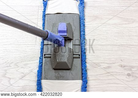 Plastic Blue And Gray Mop Wiping The Light Floor In The Flat.