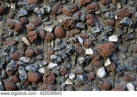 Bright Decorative Surface Of The House Wall With Stones And Rubble