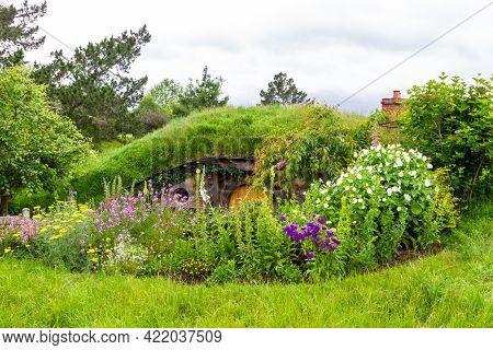 Matamata, North Island, New Zealand-11 20 2019: Hobbit cabins in Hobbiton.