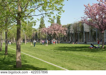 Krasnodar, Russia-may 02, 2021:people Relax On The Lawn In The Popular City Residents Park Krasnodar