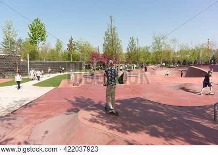 Krasnodar, Russia-may 02, 2021: Teenagers Ride On Skate Boards, Roller Skates And Scooters On A Spec