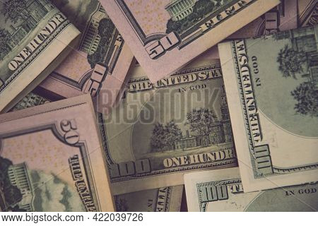Financial Background Of Mess Us Dollar Paper Cash Banknotes. Flat Lay Of Fifty And One Hundred Dolla