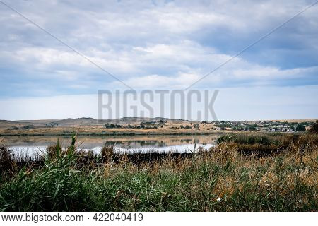 Steppe In The Summer. Swamp In The Steppe. Clouds On The Blue Sky. Green Reeds. Green Grass. Wetland