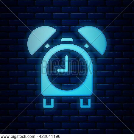 Glowing Neon Alarm Clock Icon Isolated On Brick Wall Background. Wake Up, Get Up Concept. Time Sign.