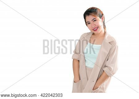 An Asian Woman Standing With Her Hand In Her Pocket And Smiling. Bangkok, Thailand.