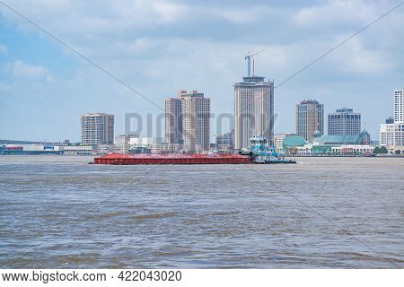 New Orleans, La - June 23: Loaded Barge Headed Downriver With City Skyline In Background On June 23,