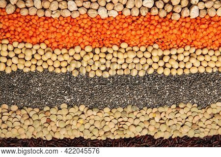 Different Grains And Seeds As Background, Top View. Veggie Diet
