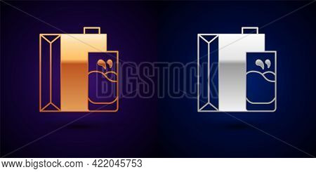Gold And Silver Paper Package For Milk And Glass Icon Isolated On Black Background. Milk Packet Sign