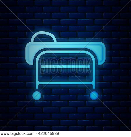 Glowing Neon Stretcher Icon Isolated On Brick Wall Background. Patient Hospital Medical Stretcher. V