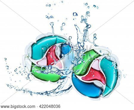 Laundry Capsules And Splashing Water On White Background. Detergent Pods