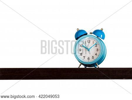 Blue Alarm Retro And Vintage Classic Design Clock Placing On Wooden Shelf With Ten O'clock Isolated