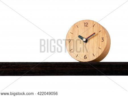 Brown Alarm Retro Classic Wooden Design Clock Placing On Shelf With Ten O'clock Isolated White Backg