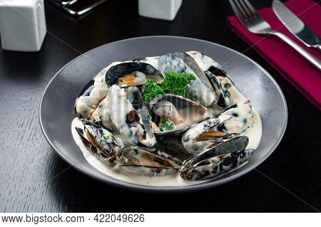 Cooked Mussels In Cream Sauce Appetizer For Wine. Sea Products. Mussel Shop.