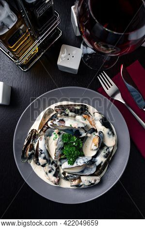 Cooked Mussels In Cream Sauce Appetizer For Wine. Sea Products. Mussel Shop