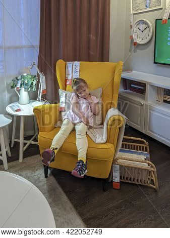 05.23.2021 Ikea, Moscow, Russia. Child Girl Chair In The Store. Buying Furniture.