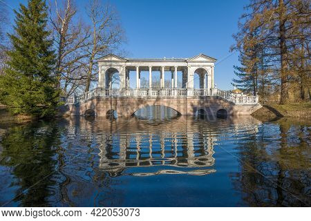 View Of The Ancient Marble Bridge On A Sunny May Day. Catherine Park In Tsarskoe Selo. Suburb Of St.