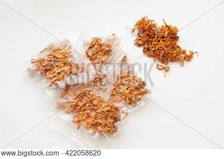 Dry Cordyceps. Fungi For Human Health. Militaris Mushroom. Dry Cordyceps. Dry Fresh Cordyceps In Vac