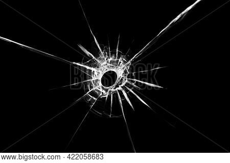 Illustration Of Broken Glass Texture With A Hole In The Center Isolated On A Black Background. The E
