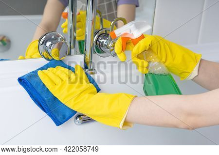 Woman Doing Chores In Bathroom, Cleaning Bathtub With Spray And Cloth