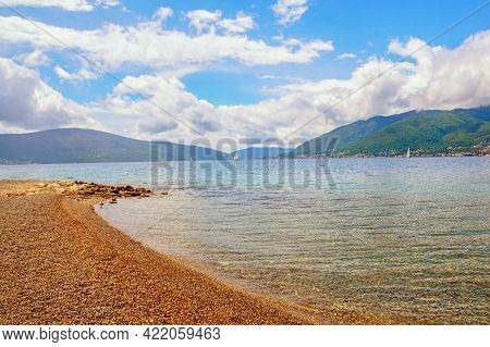 Beautiful Mediterranean Landscape.  Sky, Sea Bay And Deserted Beach.  Montenegro, Adriatic Sea, View