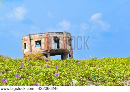 An Old Decrepit White Building Faces The Sea Near The Perupalem Beach Of Indian Ocean.