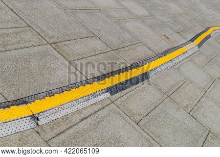 Pavement Pads To Protect Electrical Wiring On The Sidewalk (on The Road). Channel For Laying The Wir