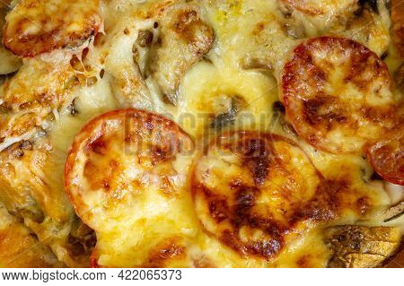 Tomatoes And Mushrooms Are Covered With A Lot Of Melted Cheese. Tomatoes And Mushrooms Are Covered W