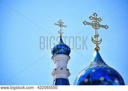 Against The Background Of A Clear Blue Sky, Two Domes Of A Christian Church Or Monastery Of Differen