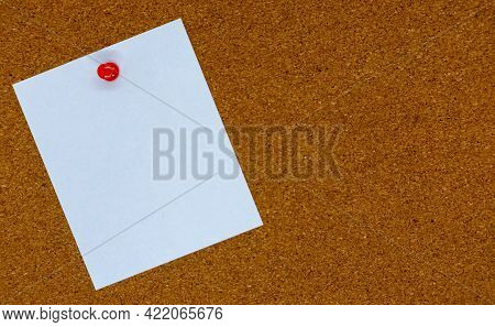 Blank White Paper Note Pinned To A Cork Board. Bulletin Board With Empty Space For Add Text Message.