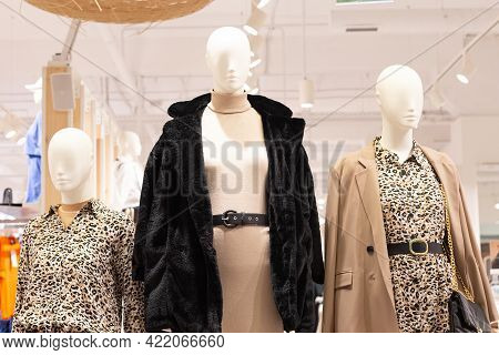 Mannequins In Fashionable Clothes. Women's Clothing And Knitwear.