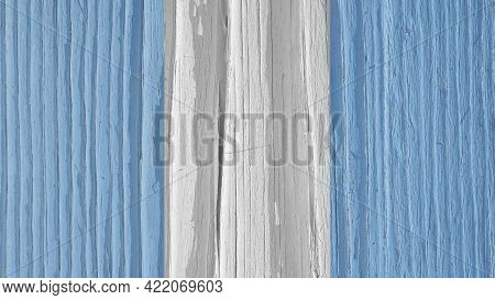 The Flag Of Guatemala On A Dry Wooden Surface, Cracked With Age. It Seems To Flutter In The Wind. Li