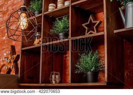 Wooden Shelving With Square Shelves Lined With Various Decor