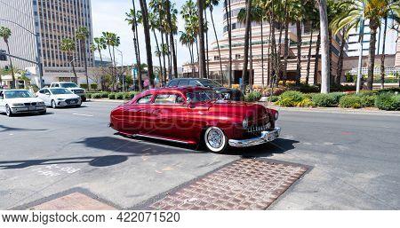 Long Beach, California Usa - April 11, 2021: Red Chevrolet Kustom Famous Retro Car Left Side View