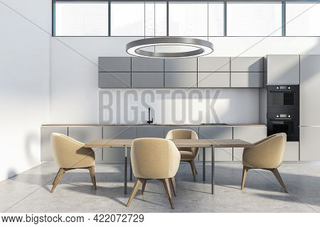 White Kitchen Set With Wooden Table And Four Beige Chairs On Grey Floor. Minimalist Dining Room With