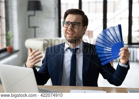 Exhausted Male Office Employee Suffering From Heat, Hot Stuffy Air