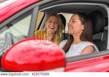 Young Beautiful Women In The Car. Happy Lady Inside The Car. Travel Together.