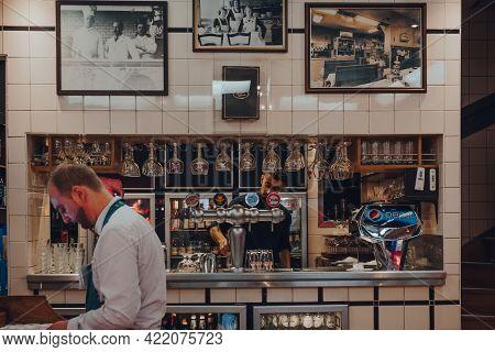 Brussels, Belgium - August 17, 2019: Bartender Working Inside Chez Leon, A Family-owned Restaurant I