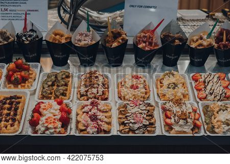 Brussels, Belgium - August 17, 2019: Belgian Waffles With A Variety Of Toppings At A Window Of La Ga