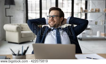 Happy Manager Relaxing At Workplace In Office, Enjoying Work Break